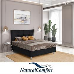 מיטה זוגית מעץ מלא מרופדת בריפוד בד קטיפה דגםכפתורים כולל מזרון